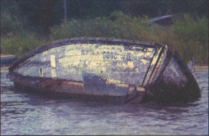 The hull of the Good Will slowly settles beneath the waters of Betsie Bay.