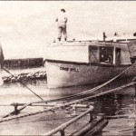 After setting nets at the Manitou Islands, the fish tug Good Will returns to Leland harbor.