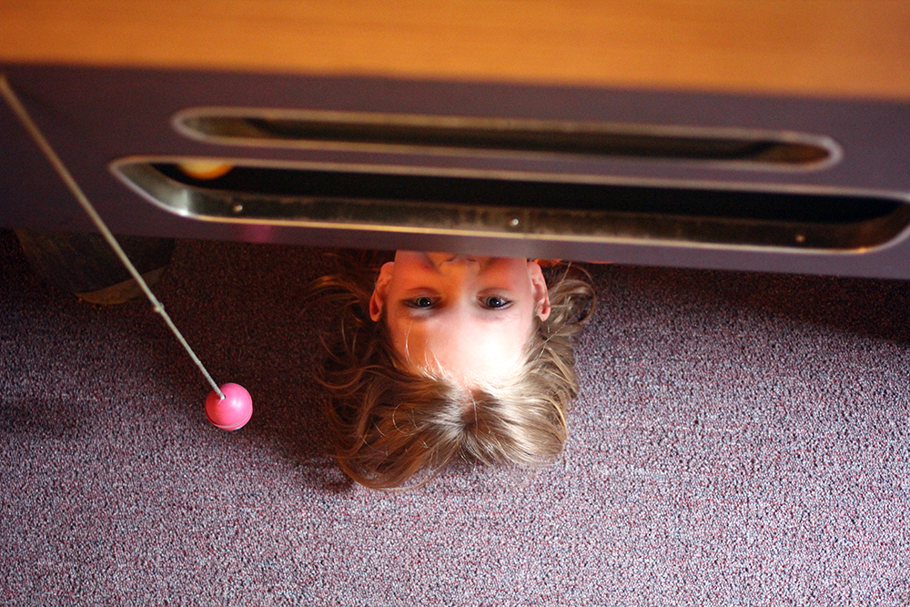 Converted pool table also makes for a great hiding spot. Photo by Aubrey Ann Parker.