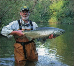 Pete Micol proudly displays a Chinook salmon.