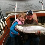 Captain Dave and his daughter Elle catch a brown trout in the Betsie Bay on Easter morning. Photo courtesy of Dave Rommell.