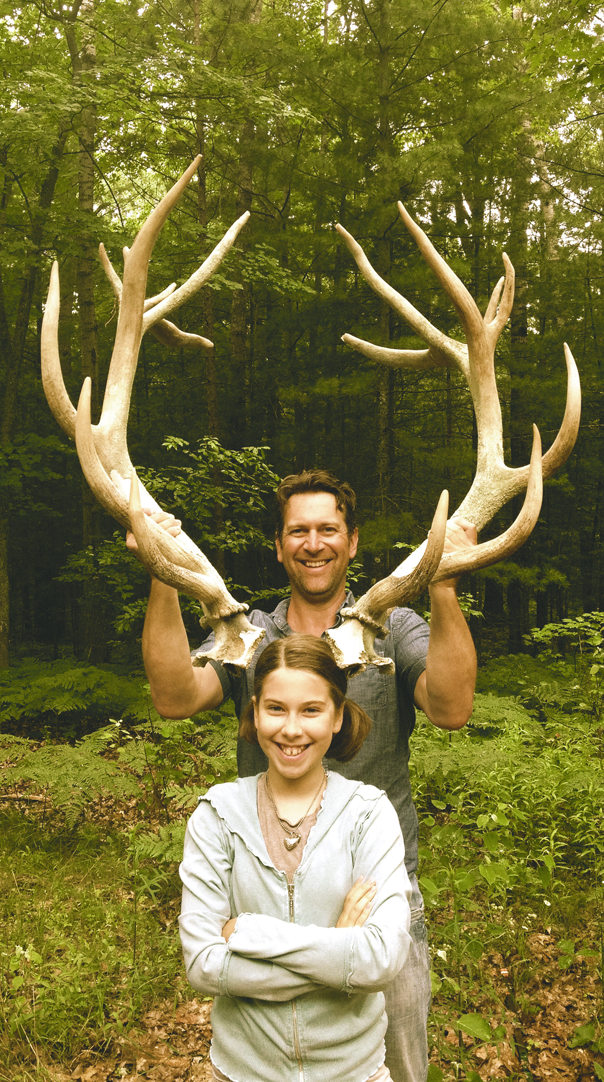 Sonja and David Moehle show the scale of their mysterious antlers. Photo courtesy of Amy Daniels Moehle.