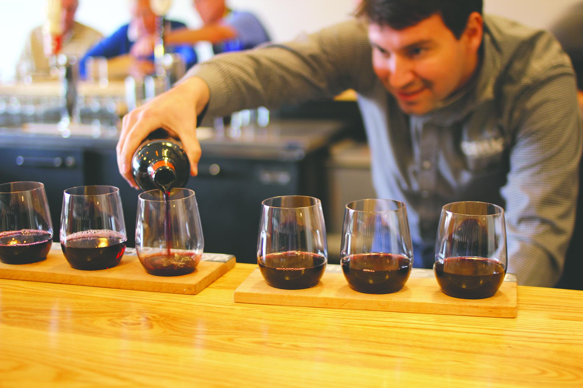 Cru Cellars owner Torrey Bingham lets the wine breathe.