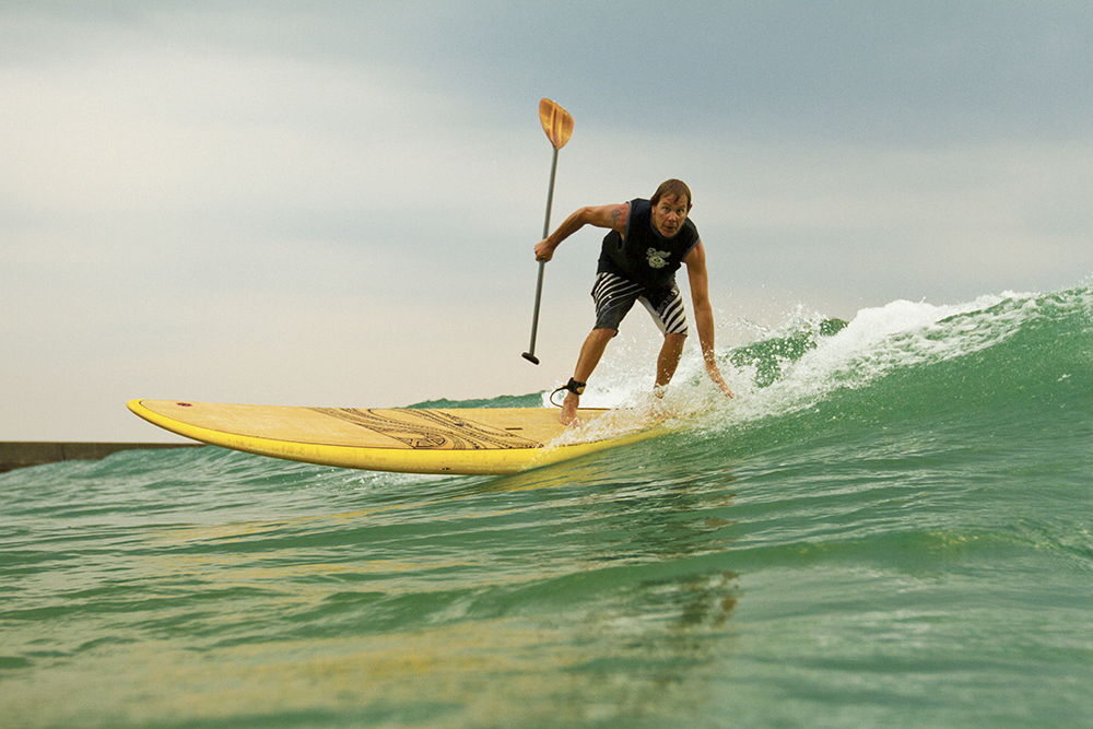 David Kadlec shows advanced stand-up paddle boarding skills. Photo by Keenan May.