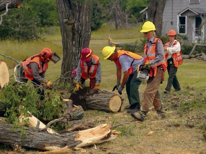 Sawyers at the Sleeping Bear Dunes National Lakeshore work to re-open Glen Haven following the megastorm. Photo by Merrith Baughman, National Park Service.