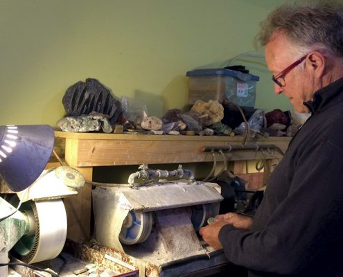 Dick Bayer in his rock shop at his home. Photo by Kelly Ottinger.