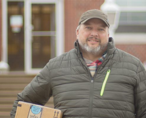 Josh Bedell is a mail carrier for the United States Postal Office. For 11 years, he worked as a substitute carrier all over the greater Northern Michigan region, including his hometown of  Frankfort, pictured here. For the past two years, however, he has had his own route in Traverse City. Photo by Aubrey Ann Parker.