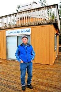 Norm Wheeler, manager of the Beach Bards bonfire in Glen Arbor, co-editor of the Glen Arbor Sun, recently retired English teacher at The Leelanau School