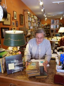 P.J. Grath, bookseller at Dog Ears Books in Northport