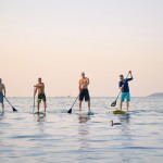 Can Lake Michigan be crossed by five men on standup paddle boards? These five dudes hope to be the first. Photo by John S. Gessner