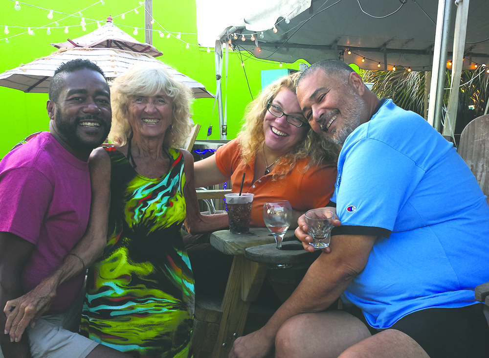 Susan Koenig, second from left, meets up with Philip Bailey, far right, and friends at a beach bar in Florida. Photo courtesy of Susan Koenig.