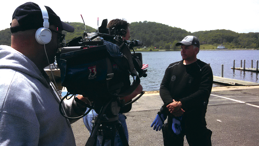 Wayne Lusardi being interviewed by a local television station. Photo by Jed Jaworski.