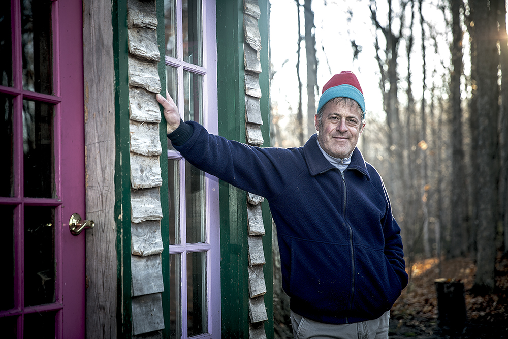 James Kudlack stands outside his sauna in the hills of Elberta. Photo by Robert Bushway Photography.