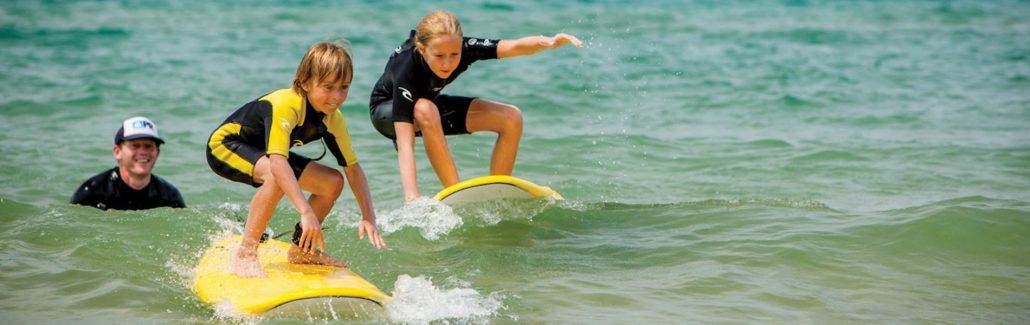 Surf lesson surfing Lake Michigan sleeping bear surf and kayak shop empire Michigan the betsie current newspaper Mae stier photography